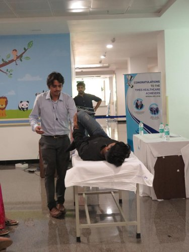 Rahul Dixit (left) and Nikhil K.B., two students from the R.V. College of Physiotherapy demonstrate exercises to ease the effects of Parkinson's Disease, in Bengaluru on April 11, 2019.