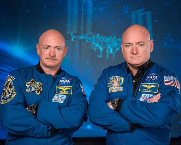 Recent photo released by NASA shows former astronaut Scott Kelly (R), who was the Expedition 45/46 commander during his one-year mission aboard the International Space Station, along with his twin brother, former astronaut Mark Kelly (L). (Photo by Robert