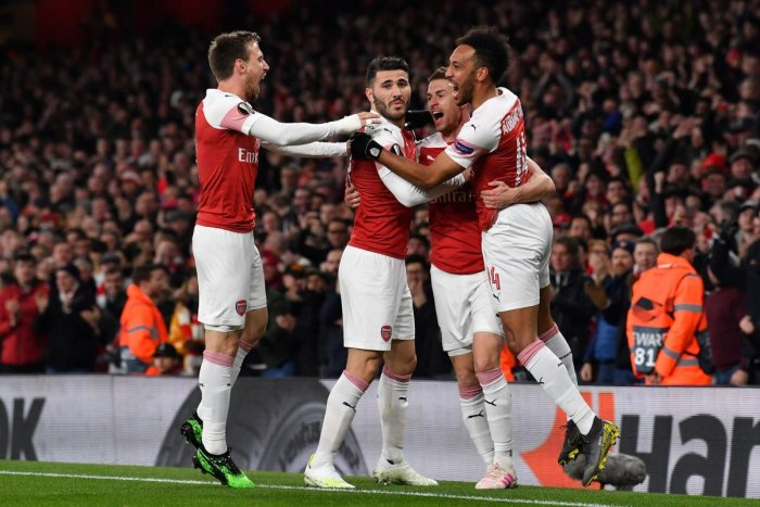 Arsenal's Welsh midfielder Aaron Ramsey (2R) celebrates scoring the team's first goal during the UEFA Europa League quarter final, first leg, football match between Arsenal and Napoli at the Emirates Stadium in London on April 11, 2019. (AFP)