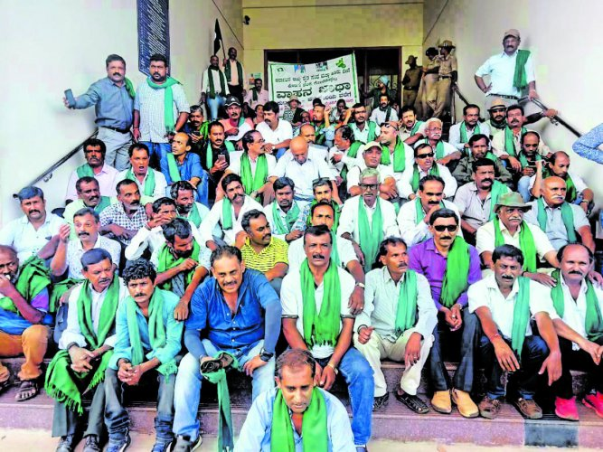 Farmers stage a protest in front of the deputy commissioner's office in Madikeri.