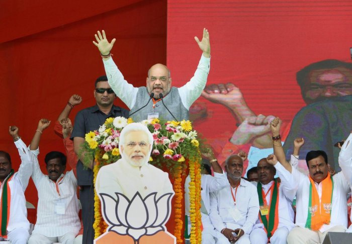 BJP president Amit Shah addresses an election rally in support of party candidate at Shamshabad on the outskirts of Hyderabad. PTI