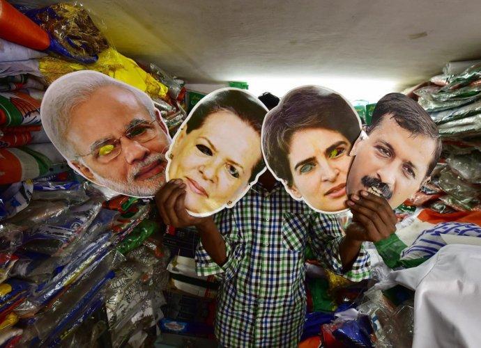 New Delhi: A salesman displays masks of Prime Minister Narendra Modi, Congress leaders Sonia Gandhi, Priyanka Gandhi Vadra and AAP leader Arvind Kejriwal at a shop, ahead of the Lok Sabha polls, in New Delhi, Wednesday, April 3, 2019. (PTI Photo/ Manvender Vashist)