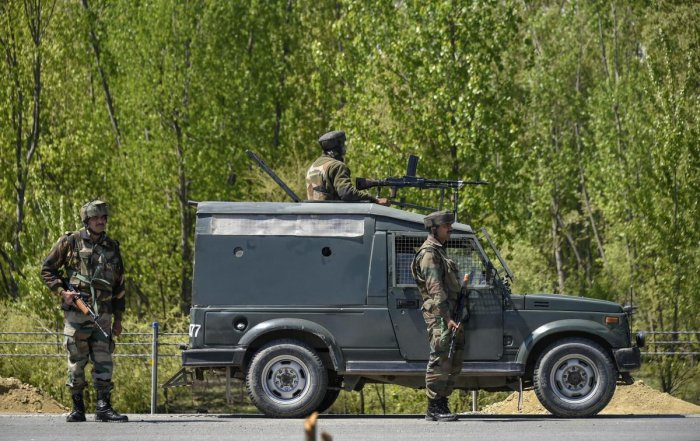 Army convoy stand guard on the Jammu-Srinagar-Baramulla national highway, on the outskirts of Srinagar, Wednesday, April 10, 2019. PTI