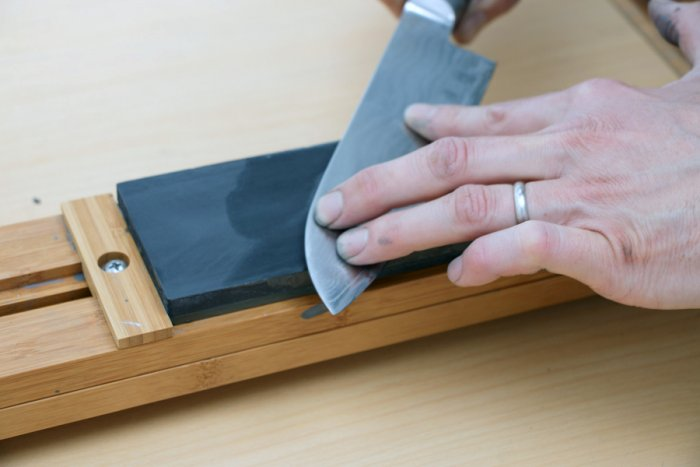 Sharpening a knife with a whetstone. Picture credit: flickr.com/ Didriks