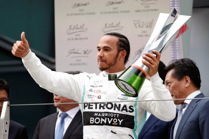 Lewis Hamilton with the trophy after winning the Chinese Grand Prix. Picture credit: Reuters