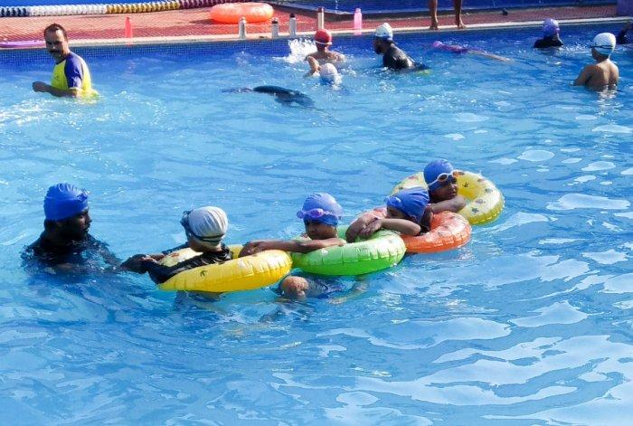 Children are enjoying the water in a summing pool , To beat the heat, in Bengaluru on Monday. Photo/ B H Shivakumar