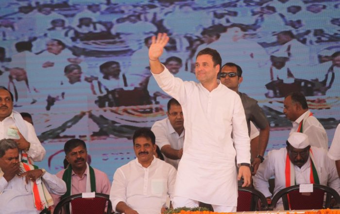 AICC president Rahul Gandhi waves at the crowd during the election rally in Kolar on Saturday. Former chief minister Siddaramaiah and AICC general secretary in-charge of Karnataka K C Venugopal is also seen. DH Photo