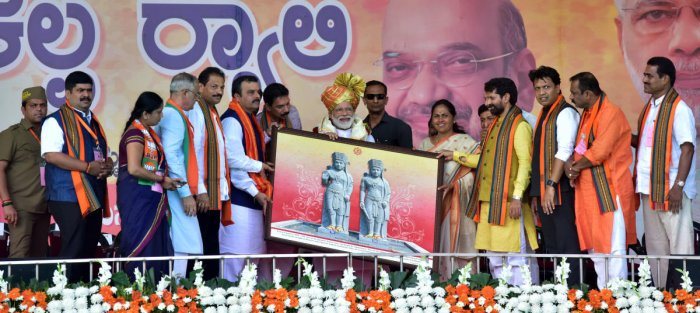 An embossing work on Koti Chennaya was handed over to Prime Minister Narendra Modi at the 'Vijaya Sankalpa' rally at Nehru Maidan in Mangaluru on Saturday.