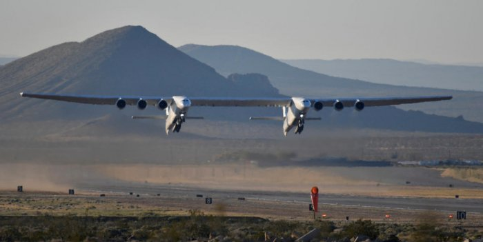 The world's largest airplane, built by the late Paul Allen's company Stratolaunch Systems, takes off on its first test flight in Mojave, California, U.S. April 13, 2019. REUTERS