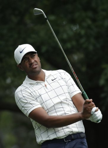 ROCK STEADY: American Tony Finau tees off during the third round of the Augusta Masters on Saturday. REUTERS