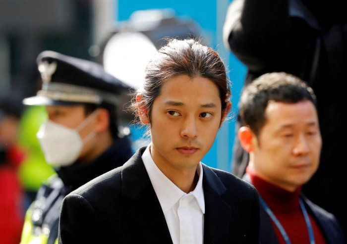 South Korean singer Jung Joon-young arrives for questioning on accusations of illicitly taping and sharing sex videos on social media, at the Seoul Metropolitan Police Agency in Seoul. Reuters file photo