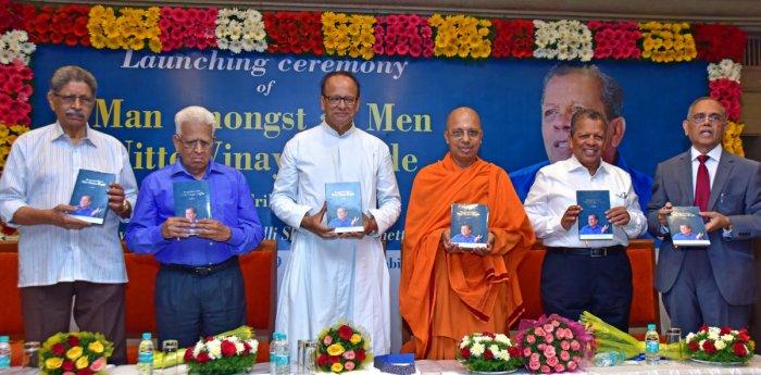 Ramakrishna Mutt, Mangaluru, President Jithakamananda releases the biography of Nitte (Deemed to be University) Chancellor N Vinaya Hegde 'Man Amongst All Men: Nitte Vinaya Hegde - A Tribute' in Mangaluru on Sunday.