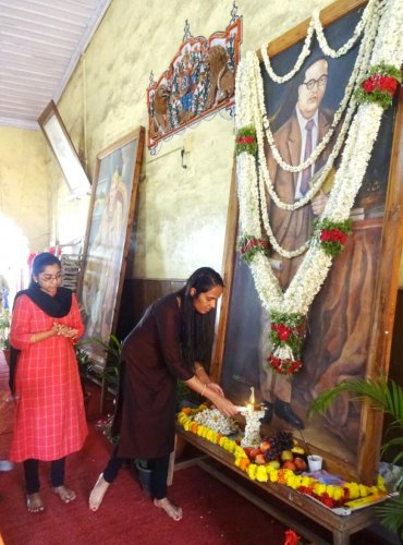 Deputy Commissioner Annies Kanmani Joy offers floral tributes to the portrait of Dr B R Ambedkar during the 128th Ambedkar Jayanti observed by the district administration, Zilla Panchayat and Social Welfare Department at the Old Fort Hall in Madikeri on S