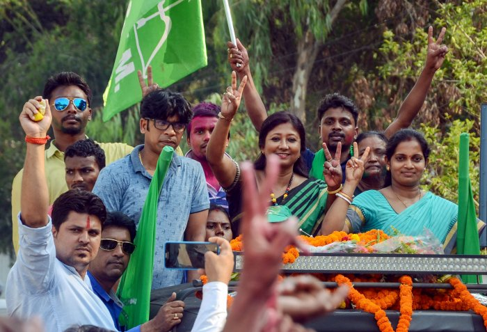 Jharkhand Mukti Morcha candidate Seema Mahato with her supporters flashes a victory sign during the victory procession after winning the Silli constituency seat, in Ranchi, on Thursday. PTI