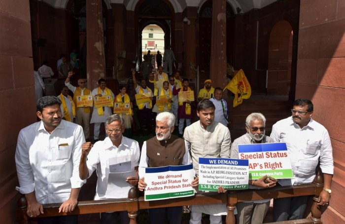 YSR Congress members display placards during a protest demanding Special Status for Andhra Pradesh at Parliament House, in New Delhi. PTI/FILE