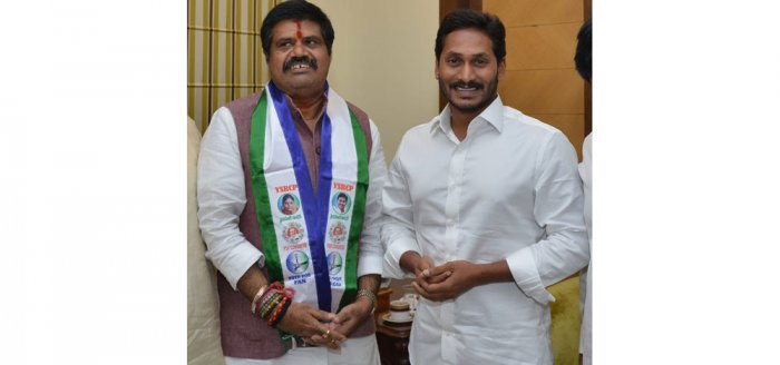 Avanthi Srinivas (with YSRCP scarf) with YS Jaganmohan Reddy at his Lotus Pond residence on Thursday.