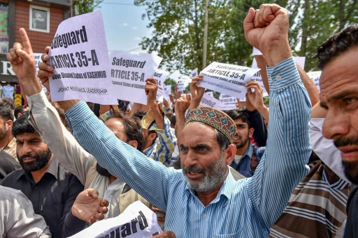 The business community in Kashmir raise slogans during a protest march against the petitions in the Supreme court challenging the validity of Article 35A, in Srinagar on Thursday, Aug 2, 2018. Article 35A, which was incorporated in the Constitution by a 1