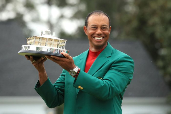 PHENOMENAL: Tiger Woods is all smiles holding the Masters Trophy after scoring a sensational one-stroke win on Sunday. AFP