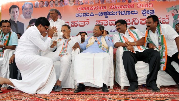 MLC S L Bhoje Gowda wishes former chief minister Siddaramaiah during a public meeting in Chikkamagaluruon Monday.