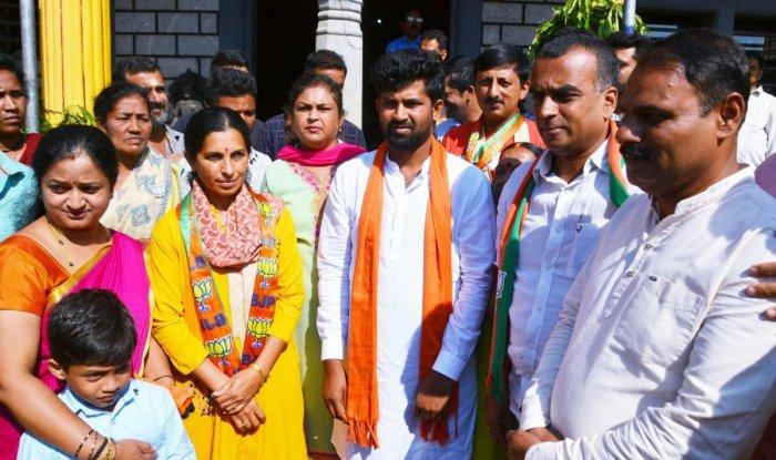 BJP candidate Pratap Simha after offering prayers at Chowdeshwari Temple in Madikeri on Monday.