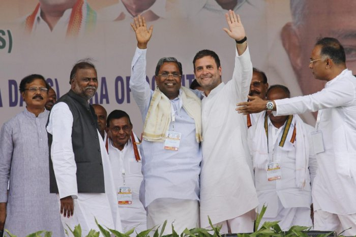 Congress President Rahul Gandhi with party leader Siddaramaiah at an election rally at Shri Jagadguru Jayadeva Murugarajendra Stadium in Chitradurga district, Karnataka, April 13, 2019. (PTI Photo)