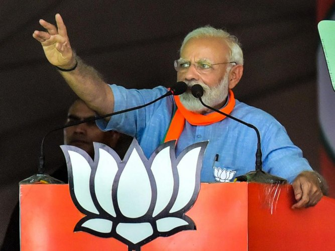 Prime Minister Narendra Modi gestures as he speaks at an election campaign rally during the ongoing general elections, in Aligarh, Sunday, April 14, 2019. (PTI Photo)