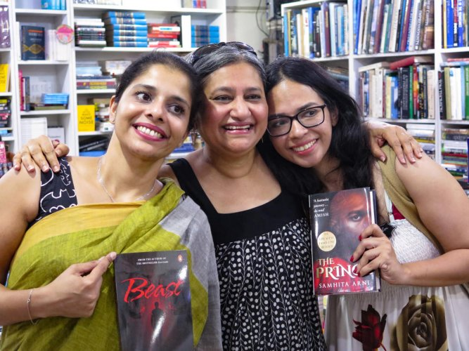 Bengaluru-based literary agent, Jayapriya Vasudevan (centre) is flanked by two of her client authors, Krishna Udaysankar (left) and Samhita Arni at a bookstore in Bengaluru on April 14, 2019. Vasudevan's literary agency represents 60 authors worldwide, including 10 authors from Bengaluru.