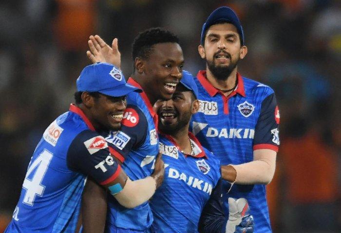 Delhi Capitals' Kagiso Rabada (2L) celebrates with teammates after taking the wicket of Sunrisers Hyderabad batsman David Warner. AFP