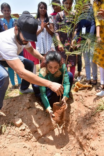 Diganth and Aindrita planting saplings at Soundarya Institute of Management and Science at Sidedahalli on her birthday on April 16.