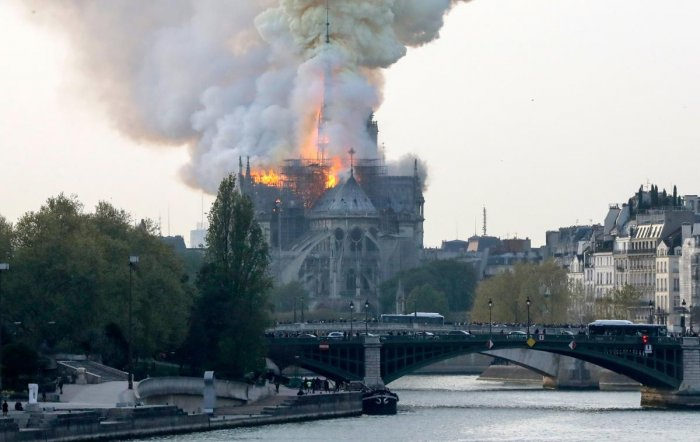 Smokes ascends as flames rise during a fire at the landmark Notre-Dame Cathedral in central Paris on April 15, 2019 afternoon, potentially involving renovation works being carried out at the site, the fire service said. AFP