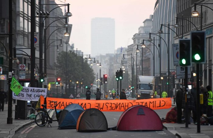 Activists block the road near Marble Arch on the second day of an environmental protest by the Extinction Rebellion group, in London on April 16, 2019. AFP photo