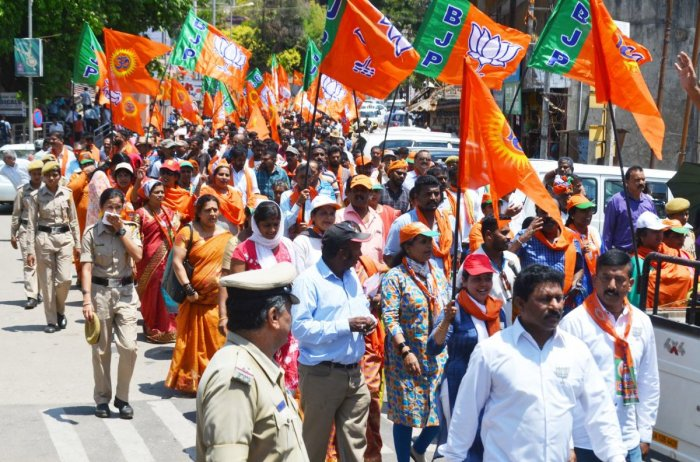 BJP workers took out a rally in Madikeri on Tuesday.