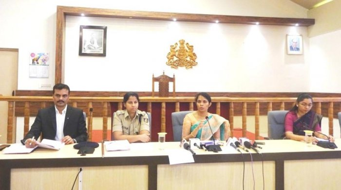 District Election Officer and Deputy Commissioner Annies Kanmani Joy briefs reporters at her office in Madikeri on Tuesday. Additional Deputy Commissioner P Shivaraju, Superintendent of Police Dr Suman D Pennekar and ZP CEO K Laksmi Priya look on.