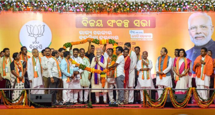 Prime Minister Narendra Modi being garlanded by party leaders during Vijay Sankalp Sabha, an election campaign for the Lok Sabha polls, in Bhubaneswar, Tuesday, April 16, 2019. PTI
