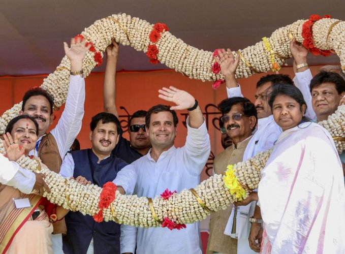 Congress President Rahul Gandhi being garlanded during 'Jan Bhawna Rally', in Purnia, Saturday, March 23, 2019. (PTI Photo)