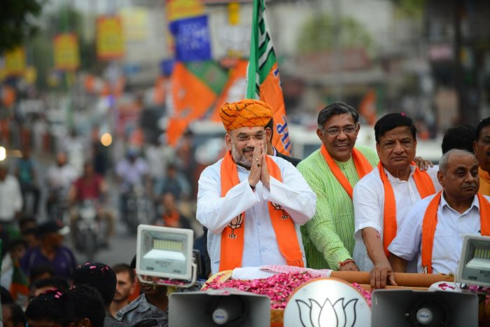 Bhartiya Janta Party (BJP) President thanks his supporters during a road show at Kalol town, some 30 km from Ahmedabad. - India's gargantuan election, the biggest in history, kicked off on April 11 with Prime Minister Narendra Modi seeking a second term f