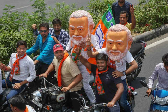 BJP supporters ride on bikes during a rally of party candidate from Jaipur, Ramcharan Bohara, ahead of his nomination filing for the Lok Sabha elections, in Jaipur, Monday, April 15, 2019. (PTI Photo)