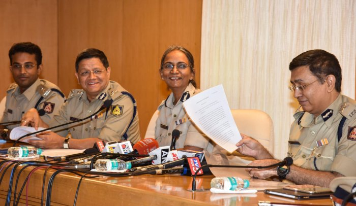 Director General and Inspector General of Police Neelmani N Raju address a press meet on security arrangements ahead of the elections in Bengaluru on Thursday. DH Photo