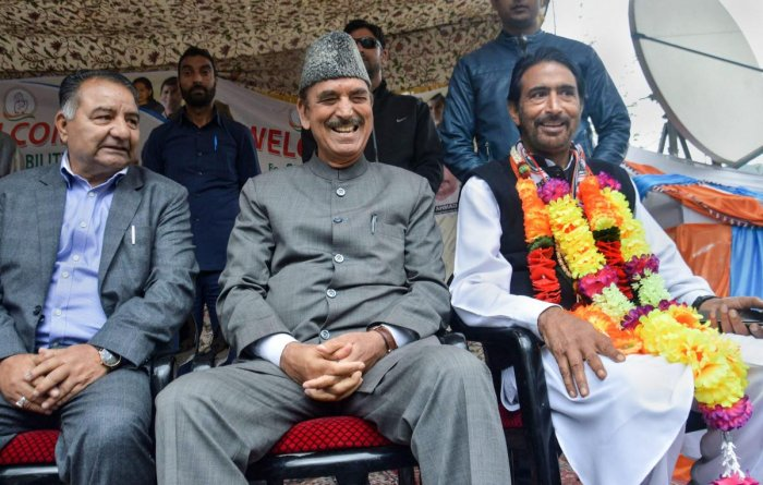 Senior Congress leader Ghulam Nabi Azad along with Anantnag parliamentary candidate & state party chief Ghulam Ahmad Mir during an election rally, in Anantnag district of south Kashmir, Tuesday, April 16, 2019. (PTI Photo)