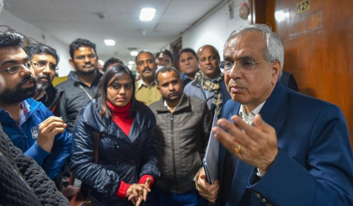 New Delhi: NITI Aayog Vice Chairman Rajiv Kumar surrounded by the media persons after a press conference, in New Delhi, Thursday, Jan. 31, 2019. (PTI Photo/Kamal Kishore) (PTI1_31_2019_000183A)