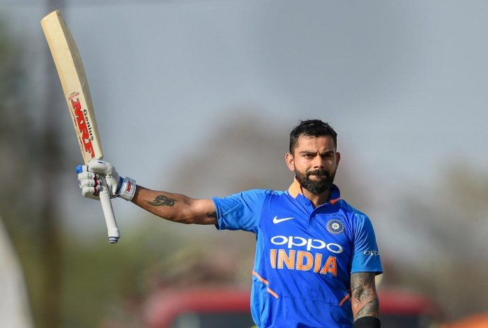 India's Virat Kohli celebrates after reaching his century during the 2nd ODI against Australia at Vidarbha Cricket Association Stadium in Nagpur. PTI photo