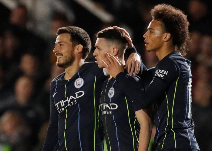FINE STRIKE: Manchester City's Phil Foden (centre) is congratulated by David Silva (left) and Leroy Sane after scoring against Newport County on Saturday. Reuters
