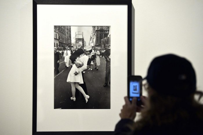 "In this file photo taken on April 30, 2013 a visitor takes a snapshot of ""VJ Day in Times Square, New York, NY, 1945"" by Alfred Eisenstaedt during the ""Life, I grandi fotografi"", (The great photographers) exhibition at the auditorium in Rome. - The sailor"