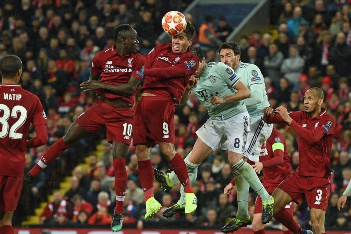 HARD BATTLE: Liverpool's Roberto Firmino (second from right) wins a header during their clash against Bayern Munich on Tuesday. AFP