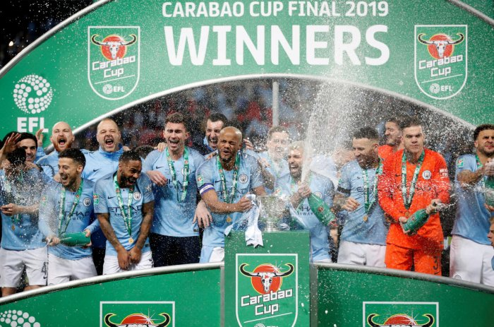 Manchester City players celebrate their victory in the League Cup final on Sunday. They beat Chelsea on penalties. AP/ PTI