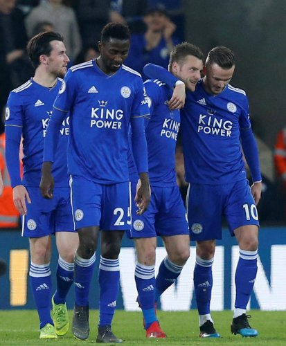 EASILY DONE: Leicester City's Jamie Vardy (second from right) celebrates with team-mates after scoring against Brighton on Tuesday night. REUTERS