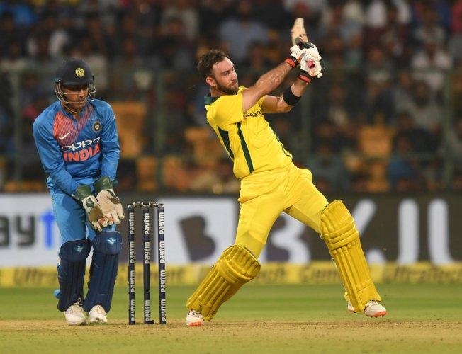 IN PUNISHING MOOD Australia's Glenn Maxwell put on show a brilliant power-hitting to guide Australia to T20 series win over India. DH Photo/ Srikanta Sharma R