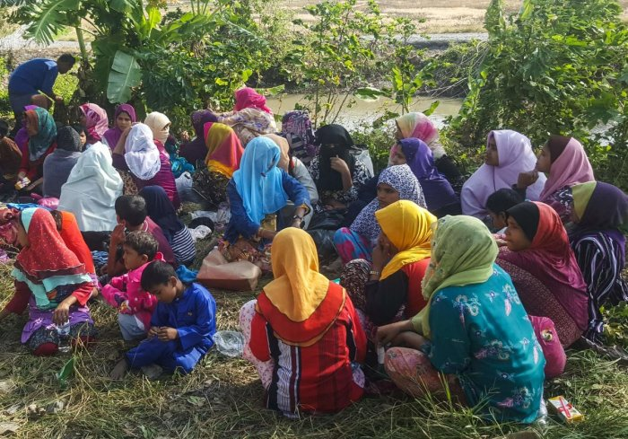 Rohingya refugees, who landed on an isolated northern shore near the Malaysia-Thai border, huddle in a group in Kangar on March 1, 2019, following their detention by Malaysian immigration authorities. - Thirty-four Rohingya landed on an isolated beach in