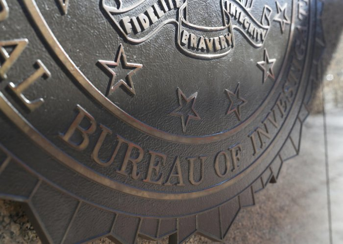The crest for the Department of Justice, Federal Bureau of Investigations is seen on the outside of the J. Edgar Hoover FBI Building in Washington, U.S., March 12, 2019. REUTERS/Leah Millis