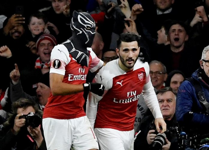 SUPERHERO SHOW: Arsenal's Pierre-Emerick Aubameyang (left) celebrates with the Black Panther mask after scoring against Stade Rennes on Thursday. Reuters